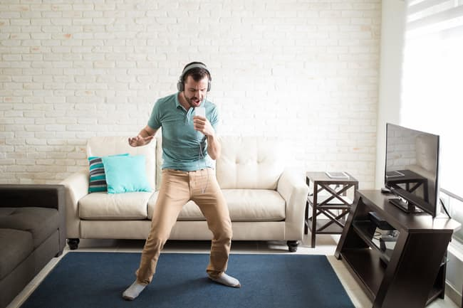 photo of man dancing in living room