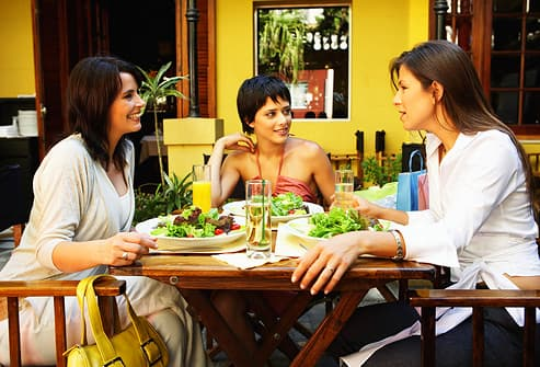 Three woman eating lunch in restaurant