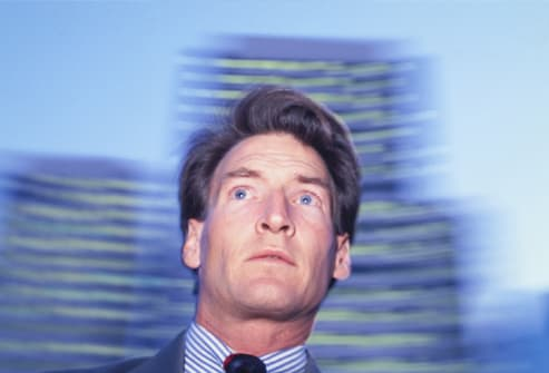Businessman with vertigo