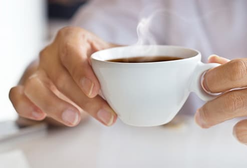 person holding hot coffee