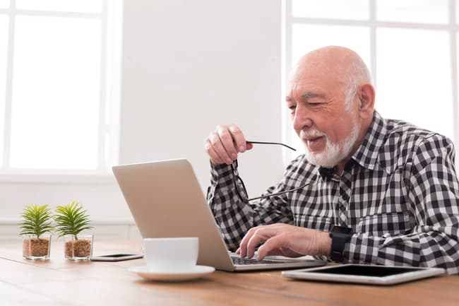 photo of man on computer
