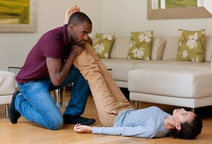man holding womans legs up