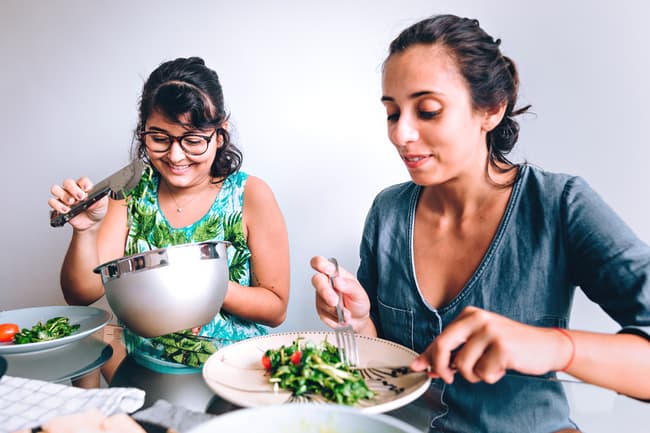 photo of women eating salad