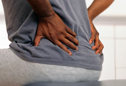 mature man with back spasm