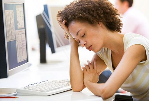 exhausted woman at computer