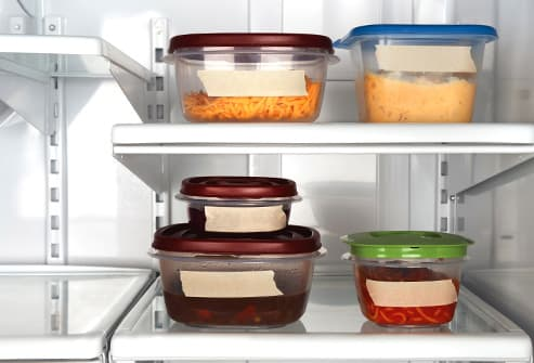 containers of leftovers in refrigerator