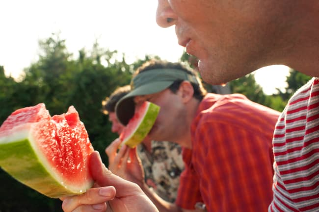 men eating watermelon