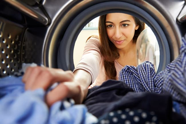 woman removing clothes from dryer