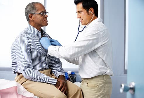 doctor checking heartbeat with stethoscope