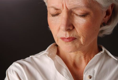 Menopausal woman suffering hot flash and sweating