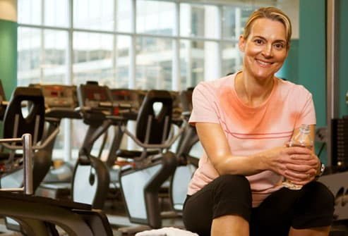 Mature woman sweating through her workout attire
