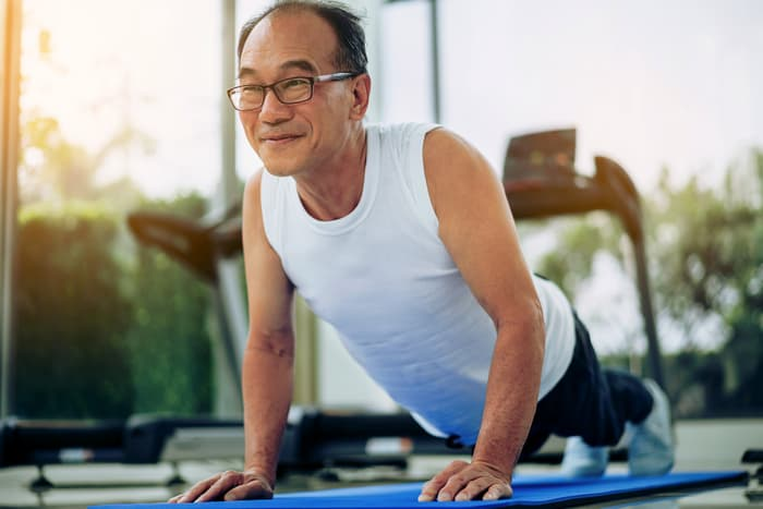 photo of mature man doing yoga