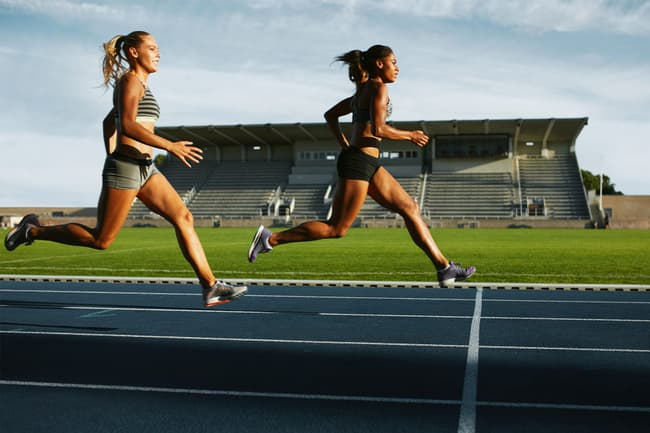photo of two women running