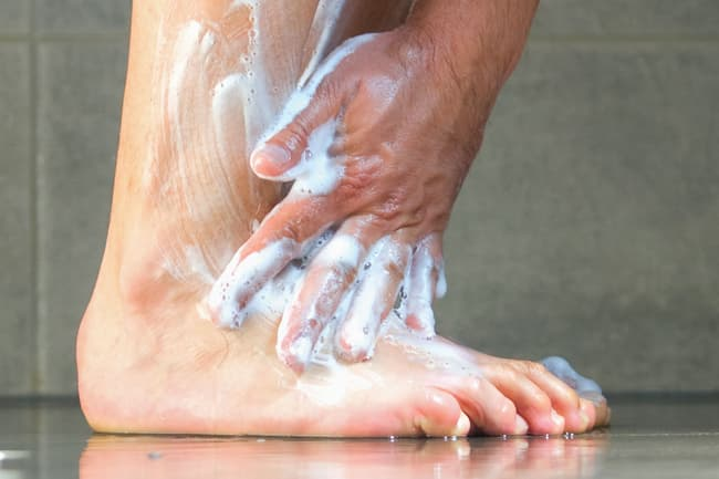 washing feet in shower