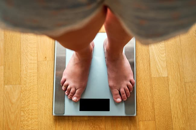 photo of feet on a scale