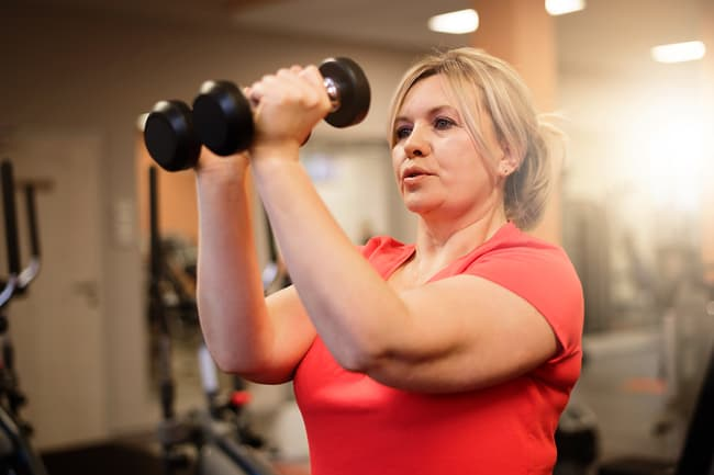 photo of mature woman lifting weights