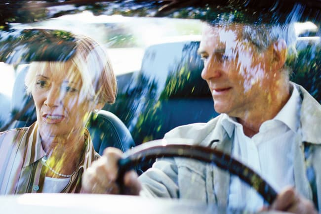 mature couple in car