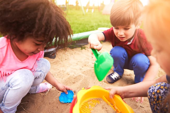 photo of children playing in sandbox