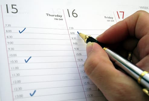 writing in weekly planner