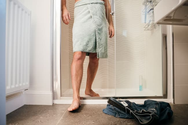 man getting out of shower