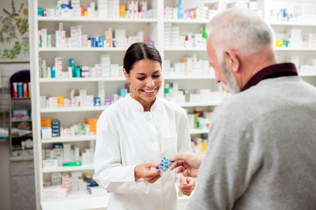 pharmacist giving medication to patient