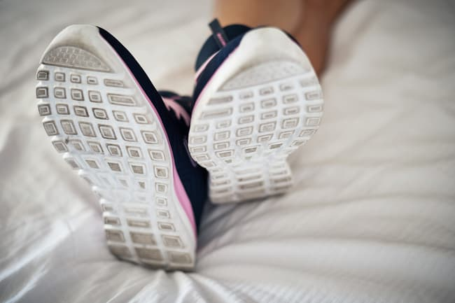 photo of shoes on bed