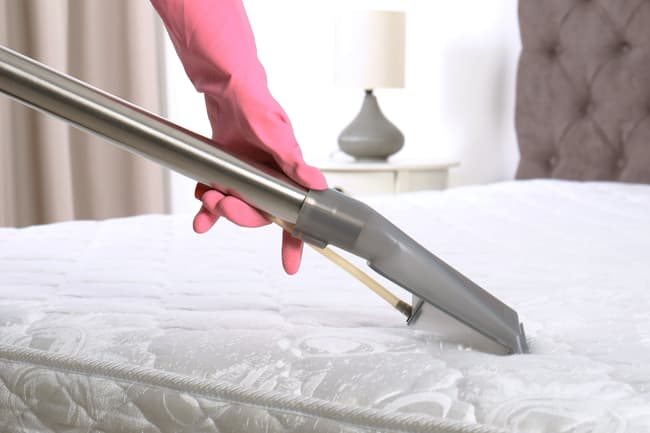 photo of vacuuming mattress