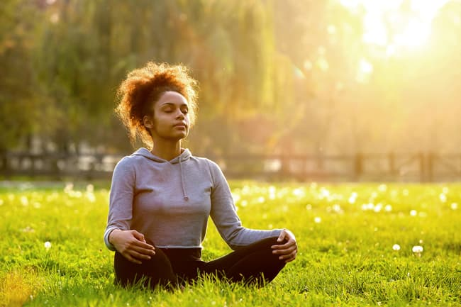 photo of woman meditating