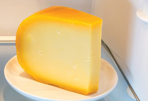 wedge of cheese in refrigerator