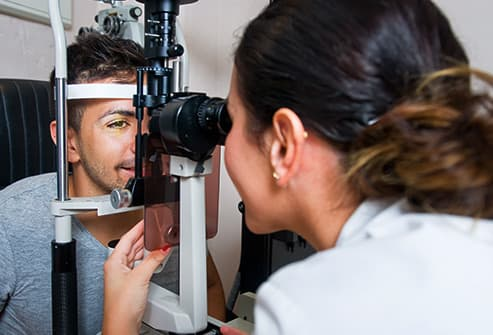 doctor looking at patients eye