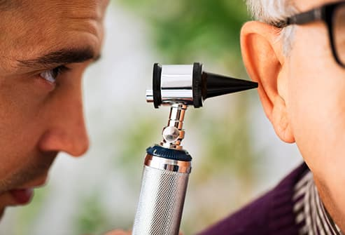 doctor examining patient ear