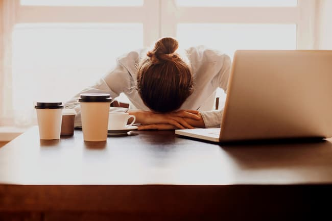 photo of tired woman at work