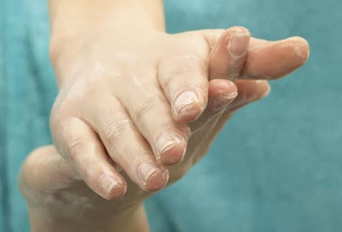 Young Woman Moisturizing Hands