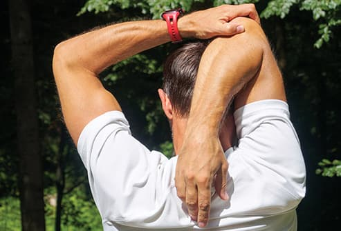 man stretching outdoors