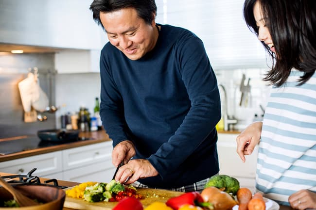 photo of couple preparing healthy meal