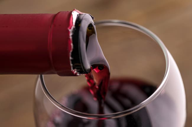 photo of pouring red wine
