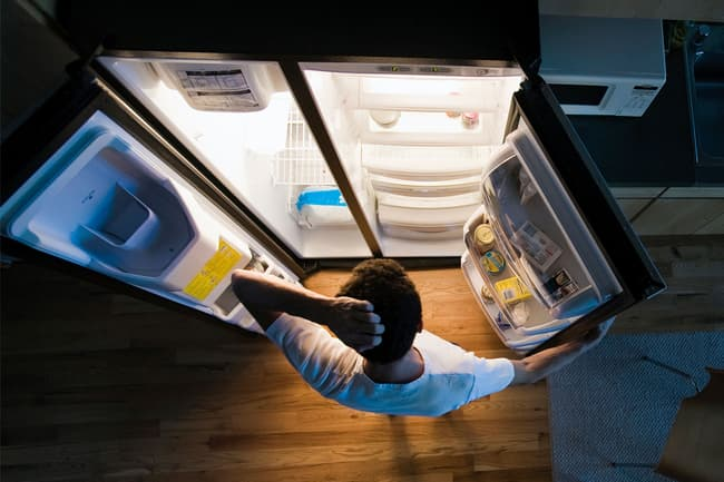 photo of looking in fridge at night