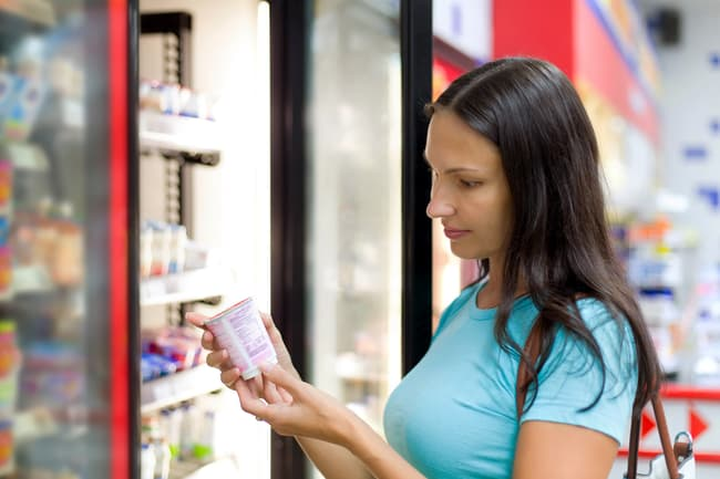 photo of woman reading food label