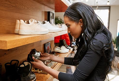 photo of woman shoe shopping