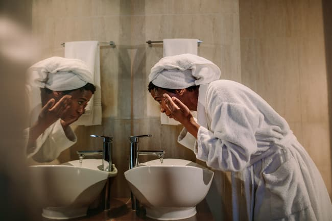 photo of woman washing face