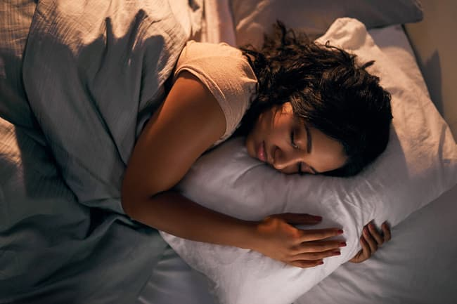 photo of woman asleep in bed