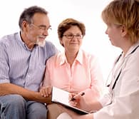 doctor talking to couple