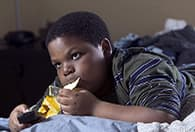 child eating in bed