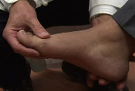 doctor looking at patient's foot