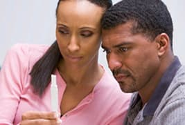 couple looking at pregnancy test result