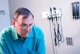 middle aged man in exam room