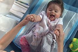 baby on changing pad