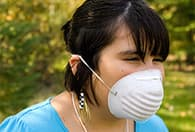 girl with dust mask