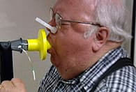 man doing lung test
