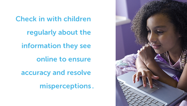 Child reading online. Check in with children regularly about the information they see online to ensure accuracy and resolve misconceptions.
